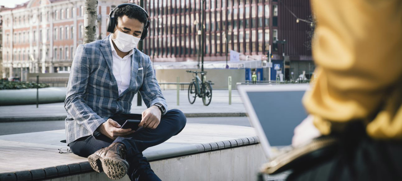 Man with phone and mouth piece
