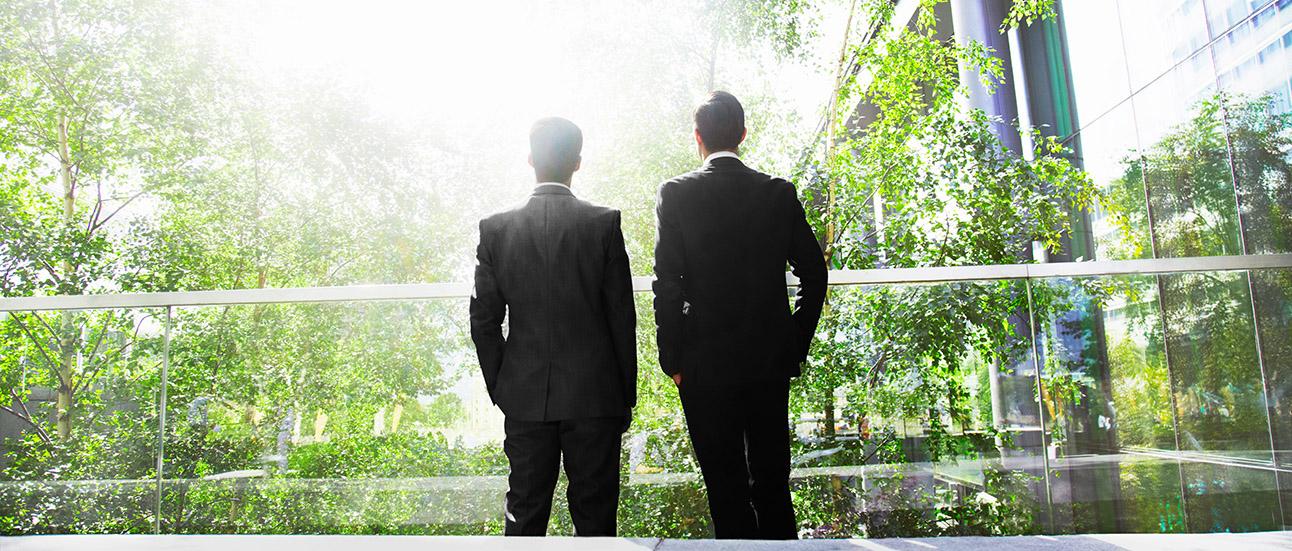 two men in green office
